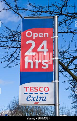 Open 24 Hrs Tesco Extra Sign - Stock Photo