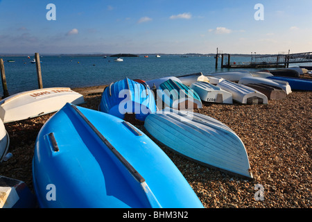 Dinghies on the beach at Eastney, Langstone Harbour, Hampshire, Uk - Stock Photo