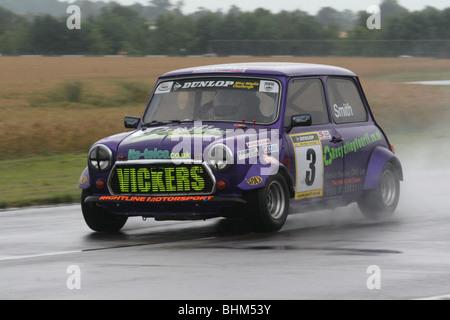 Mini Miglia Challenge at the British Motorsport Festival at Castle Combe, Wiltshire. - Stock Photo