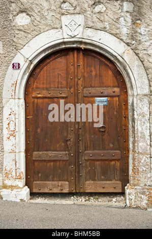 A traditional wooden doorway in Switzerland - Stock Photo