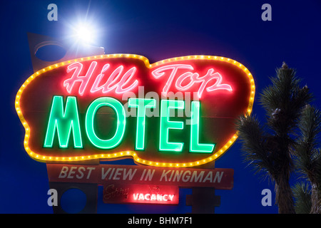 Landmark neon sign of the Hill Top Motel along Route 66 in Kingman Arizona USA at dusk. - Stock Photo