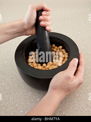 Chickpeas in a mortar and pestle - Stock Photo