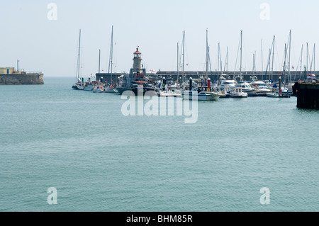 The harbour entrance and West Pier in The Royal Harbour, Ramsgate, Kent, UK. The pier light can be seen on the end - Stock Photo