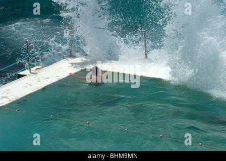 A lone swimmer resting at the Bondi Icebergs pool, Bondi Beach, Sydney, New South Wales, Australia - Stock Photo