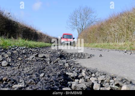 Pothole - Dangerous road in the UK - Stock Photo