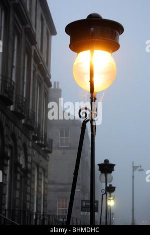 Edinburgh street lamps in fog, Scotland, UK - Stock Photo