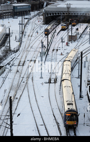 Commuter train leaving the east end of Waverley Station, Edinburgh, Scotland, UK. - Stock Photo