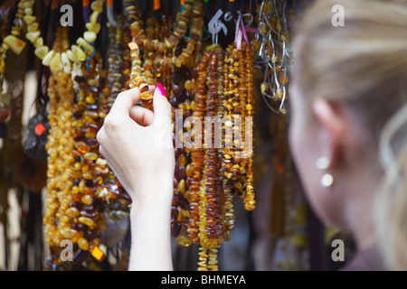 Woman Holding Amber Jewellery, Vilnius, Lithuania, Baltic States, Eastern Europe - Stock Photo