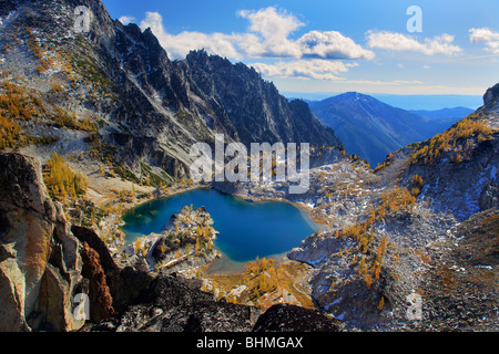 Larch trees at Crystal Lake in the Enchantment Lakes wilderness - Stock Photo