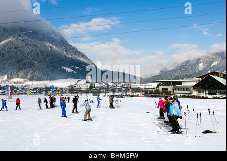 Ski school on the nursery slopes just outside the resort of Soll, SkiWelt ski region, Tyrol, Austria - Stock Photo