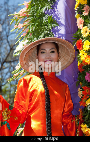 Asian woman in traditional silk dress: People of and in the 34th Chiang Mai Flower Festival, 2010 Northern Thailand, - Stock Photo