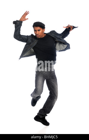 African American hip hop dancer performing over white background - Stock Photo