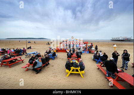 A group of bikers take a break from a Harley Davidson rally on the beach at Weston-Super-Mare UK - Stock Photo