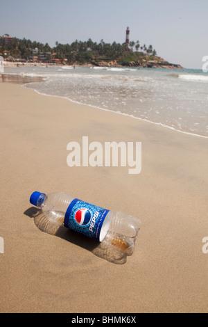 India, Kerala, Kovalam, Lighhouse Beach, discarded plastic soft drinks bottle on shore - Stock Photo
