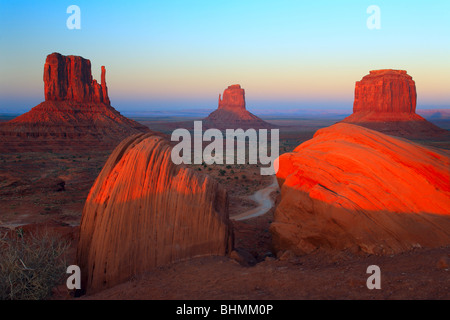 Classic view of the Mittens and Merrick Butte in Monument Valley, AZ - Stock Photo
