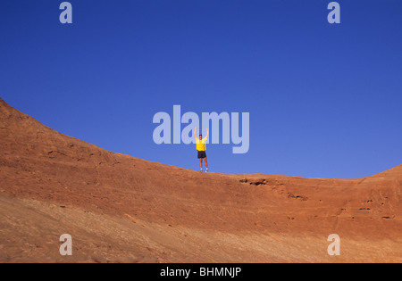 Man with arms overhead in victory. - Stock Photo