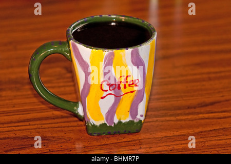 cup of coffee with coffee spelled out on coffee cup - Stock Photo