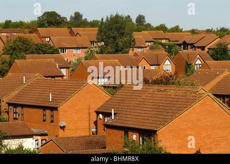 Modern red brick family homes. Milton Keynes, Buckinghamshire, Bucks England 2000s HOMER SYKES. - Stock Photo