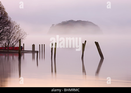 Misty morning on the banks of Derwent Water, Lake District National Park, Cumbria, England, UK. Autumn (November) - Stock Photo