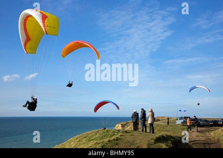 Paragliders above sea cliffs at Cap Gris Nez, Côte d'Opale, France - Stock Photo