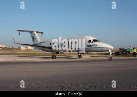 Medavia Beech 1900D turboprop commuter plane at Malta International Airport - Stock Photo