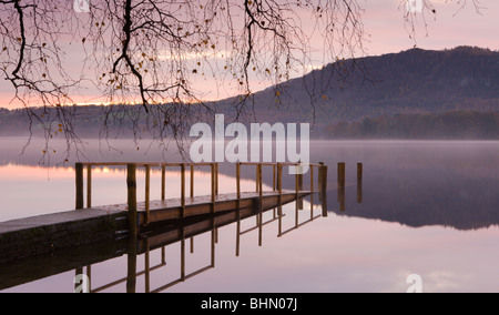 Sunrise over Derwent Water from Hawes End jetty, Lake District National Park, Cumbria, England, UK. Autumn (November) - Stock Photo