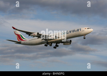 SriLankan Airlines Airbus A340-300 four-engine long haul passenger jet airliner on approach - Stock Photo