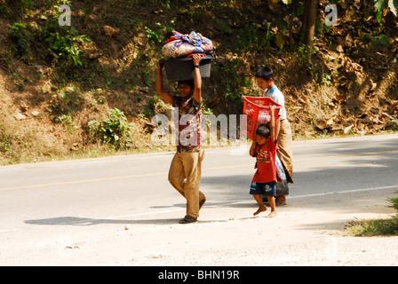 karen refugee's going to stream to wash clothes, mae la refugee camp , near mae sot , north thailand - Stock Photo
