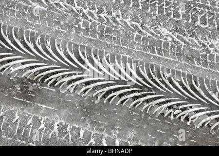 Tyre tracks in ice. - Stock Photo