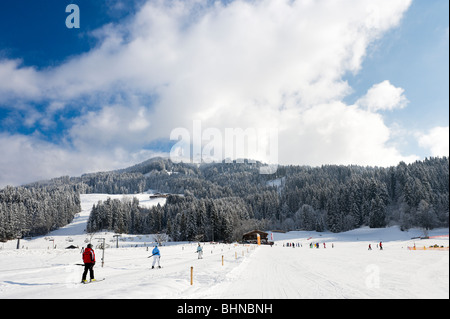 Drag lift and nursery slopes just outside the resort centre, Westendorf, Tyrol, Austria - Stock Photo