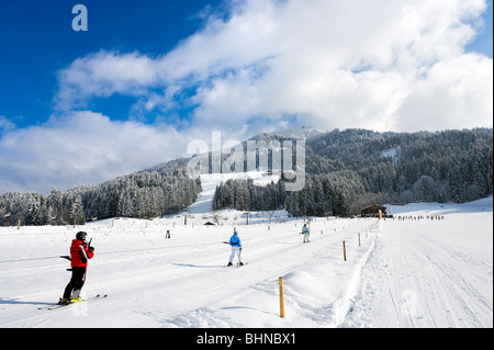 Drag lift on the nursery slopes just outside the resort centre, Westendorf, Tyrol, Austria - Stock Photo