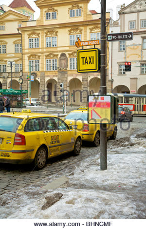 Prague Taxi Stand in Malá Strana (Old Town) with Fair Place sign. - Stock Photo