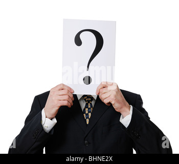 Anonymous Businessman Holding a Question Mark in Front of His Face - Stock Photo