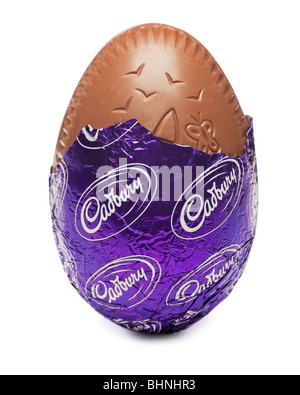 Easter egg Cadburys close up in foil half unwrapped - Stock Photo