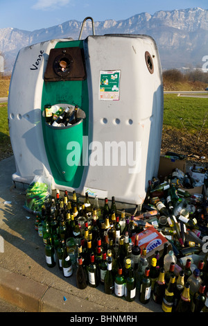 Overflowing / full recycling collection point and bottle bank near Aix les Bains. Savoie (Savoy) (Alpine) department - Stock Photo