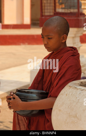 Young monk in red robe - Stock Photo
