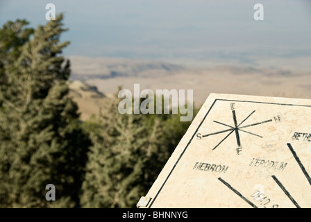 Sign board pointing to the promised land at mount Nebo, Jordan, Asia. - Stock Photo