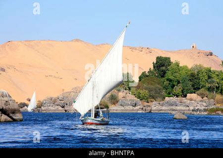 Two feluccas sailing around Elephantine Island in Aswan, Egypt - Stock Photo