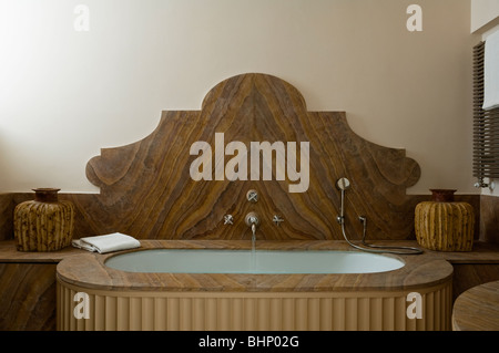 Wood grain bathtub in bathroom of converted Italian farmhouse - Stock Photo