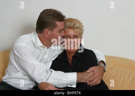 Happy 40s couple portrait kiss - Stock Photo