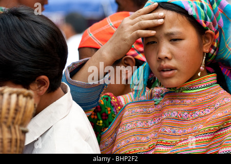 Flower H'mong girl at Bac Ha market in north Vietnam. - Stock Photo