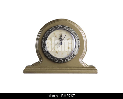 Golden table clock showing twelve o'clock isolated on white background - Stock Photo