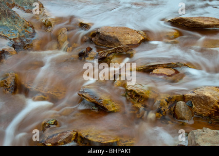 Colourful waterfall in Riotinto, (Rio Tinto) Huelva, Andalucia, Spain. This picture of a river was taken using a - Stock Photo
