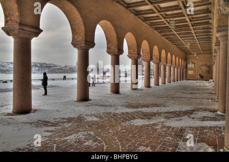 Looking out through the arches of City Hall Stockholm - Stock Photo