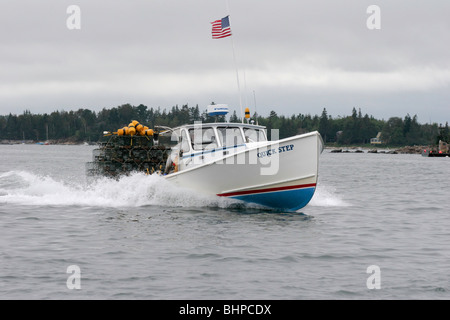 The Lobster Boat QUICK STEP hustles past on its way to setting some traps - Stock Photo