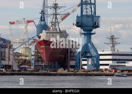 A Burke Class Aegis guided missile destroyer under construction for the US Navy at Bath Iron Works in Maine - Stock Photo