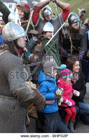 Jorvik Viking Festival 2010 York North Yorkshire England Tourists posing for photographs with the warriors. - Stock Photo