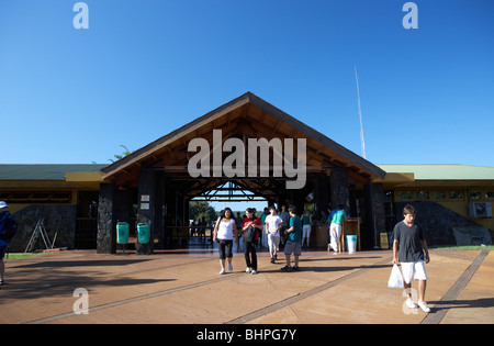 tourists inside the entrance to iguazu national park, republic of argentina, south america - Stock Photo