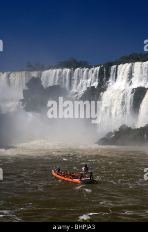 tourists on speedboat approaching the waterfalls at iguazu national park, republic of argentina, south america - Stock Photo