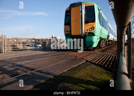 Seaford to Brighton train passing over Tide Mill Level/ Access Crossing in Sussex situated on the Seaford - Newhaven - Stock Photo